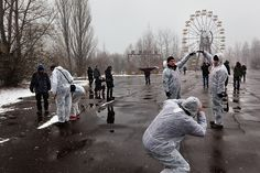 On April 26, 1986, this amusement park in Pripyat with bumper cars and a Ferris wheel was being readied for the annual May Day celebrations when the nearby reactor blew up. Rotting away for 25 years, it has since become a symbol of the utter abandonment of the area. Now it is an attraction for tourists who have started flocking to the zone in droves. Pripyat, Ukraine, 2011 (Gerd Ludwig/INSTITUTE)#