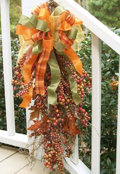 Fall Floral Arrangement for your door: A swag of ribbons and berries Make 2 Christmas one on each side of the porch.