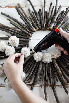 Make a twig and pom pom starburst wreath— It's practically free!