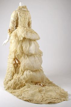 Dress Date: 1870s Culture: American Medium: cotton Dimensions: [no dimensions available] Credit Line: Gift of Richard Martin, 1993 Accession Number: 1993.35.2a–c