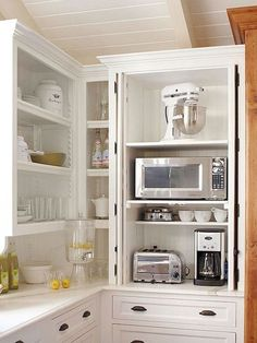 Countertop cabinet to hide kitchen appliances that are often used. MUST figure out how to get this.