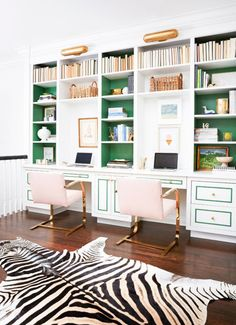Emerald-green panel-silhouettes and shelf-backs add a pop of color to the home office. Accenting in blush (those chairs) is so now.