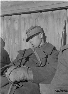Finnish soldier taking a nap after Petroskoi is captured 1941.10.01