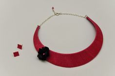 Pink necklace with black flower and earrings