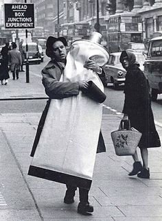 Claes Oldenburg with a giant tube of toothpaste. London, 1966.