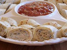 Simple & Quick - Texas Tortilla Roll-Ups: cream cheese, soften, sour cream, green onions, chopped green chilies, shredded sharp cheddar cheese, black olives, flour tortillas, picante sauce