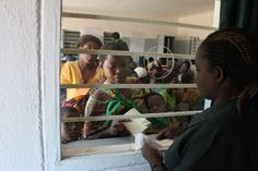 Patients and guests at the Nandumbo Health Centre are attended to #Malawi #HELPchildren #HealthCentre