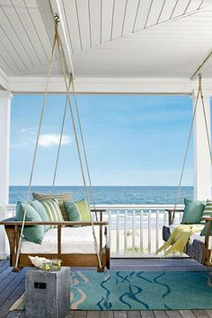 Enjoy these swinging lounges at this beach house for your next holiday.