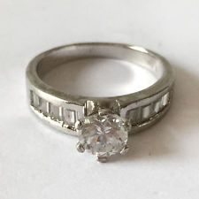 Sterling silver rhodium plated solitaire ring with 6 prongs set round... Lot 140
