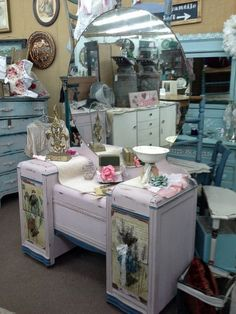 $275 - This vintage vanity has a large round mirror and 4 drawers for storage. Painted pink with blue accents , it has been heavily distressed. It measures 46 inches across the front, 18 inches deep and it stands approximately 72 inches to the tallest point. It can be seen in booth D 8 at Main Street Antique Mall 7260 East Main St ( E of Power Rd ) Mesa 85207 480 9241122open 7 days 10 till 530  Cash or charge 30 day layaway also available