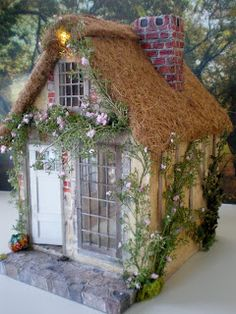 Cottage dollhouse - many photos of the details and discussion of how she made parts of it - always been fascinated by highly detailed miniatures - I might have to try my hand at it someday, or just continue to do very upscale decorative birdhouses. :)  (she also has a book on building dollhouses, might want this!) from Cinderella Moments: Marie Antoinette Cottage Dollhouse - #birdhouse #dollhouse #miniatures #crafts tå√