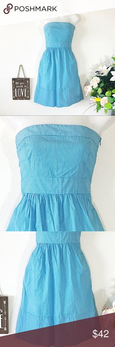 Zara Strapless Striped Blue Dress With Pockets Zara Basic strapless dress in excellent condition; XS; gathered elastic mid back; coordinating vertical and horizontal placement of narrow striped fabric.It has a side zipper and side seam pockets. Zara Dresses Mini
