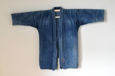 """vintage Kendo kimono hard damaged/distressed indigo dyed thick cotton boro sashiko stitched embroidered name in Japanese character upper kimono in double layer stitched bottom in diagonal quilted patterns distressed fabric / loose stitches on collar & shoulder  measurement - wingspan: 51"""" - armpit to armpit: 24"""" - length: 33""""  pre-owned condition please see pictures for best explanation  HAPPY SHOPPING!  @@@ PLEASE VISIT MY SHOP - to view for treasures @@@ www.etsy.com/shop..."""