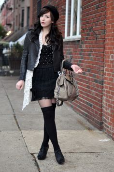 Lace jacket paired with leather jacket. Glorious.