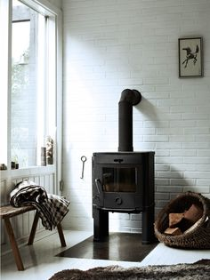 Whitewash brick behind wood stove? Possibly paint wood stove medium gray? Idea from The Stuff of LIfe by Hilary Robertson, Photography by Anna Williams Brick And Wood, Brick Wall, Living Spaces, Living Room, Home And Living, Interior Inspiration, Interior And Exterior, Sweet Home, Decoration