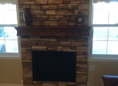 Frontier Ledge (Color: Ivory) fireplace by Jensen Masonry in Raymond AB | Manufactured Stone Veneer from Kodiak Mountain Stone