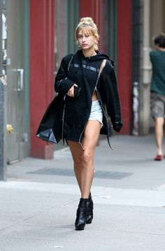 Hailey Baldwin Seen in Soho wearing hood by air plain double zip hoodie and saint laurent classic hanis ankle boots