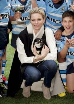 "Princess Charlene of Monaco poses with her dog ""Monte"" during Sainte Devote rugby tournament in collaboration with Princess Charlene Foundation at Louis II Stadium in Monaco 11.04.2015."