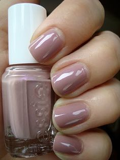 Wedding day nail varnish. Such a pretty blend of mauve and soft dusty pink: Essie Demure Vixen.
