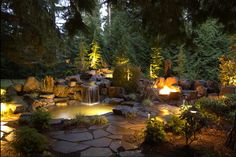 Rustic Landscape/Yard with Fire pit, exterior stone floors, Hinkley Lighting 1502 LED Path Light, Pond