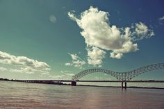 memphis...born...as a 3 year old my Daddy would put down the top of his 49 Buick convertible. We'd go downtown to see the colored lights on the fountain then I would lie in the back seat and he would drive over this bridge with me looking up at a million steel trusses.