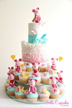 Ruffles, ombre, butterflies AND Piglet?! Omgggg this will officially be my own next bday cake!! Lol.  Via- Bella Cupcakes: Miss Ashton Sky's Cupcake Tower