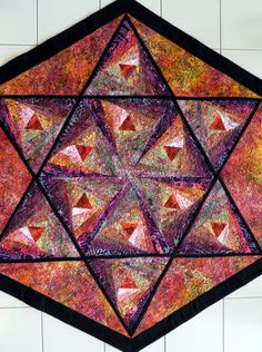 Star of David quilted tablecloth purples reds golds black