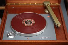 A Rek-O-Kut Rondine turntable with a Pickering tonearm in a custom case.