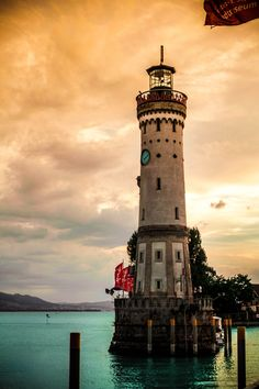 Lighthouse Lindau Germany The Lindau Lighthouse is the southernmost lighthouse in Germany, located in Lindau on Lake Constance. It is 33 metres tall and has a perimeter of 24 metres at its base. Notably it has also a clock in its facade. by margo Lindau Germany, Bavaria Germany, Places Around The World, Around The Worlds, Lighthouse Pictures, Beacon Of Light, Places To See, Beautiful Places, Vacation