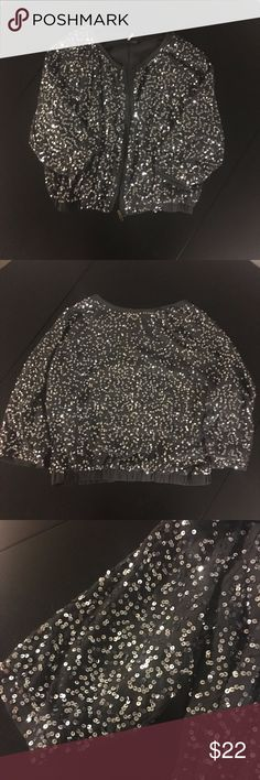"""Sparkle & Fade Gray Sequin Zip-up Bomber Jacket Great for your holiday parties! Super cute cropped sequin bomber jacket with 3/4 length sleeves from Urban Outfitters, size small. A few missing sequins and loose thread (see fifth picture), but not obvious as sequins are not in a pattern. Measurements are approx.16.5"""" from collar to bottom of hem, 19.75 from bottom of sleeve to collar, 22"""" across at waist. Sparkle & Fade Jackets & Coats"""