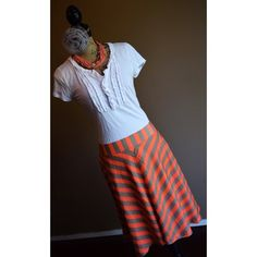Orange & Taupe Striped Skirt Orange & Taupe Striped Calf-Length Skirt by Outback Red. Size Large. Zips on the side. Never worn. New with tags. Outback Red Skirts Midi