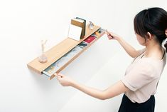"It's a simple, unassuming floating shelf that appears to be made from a single piece of timber. But 2 stubs of wood that conceal magnets act as ""keys,"" revealing a secret 23mm drawer that can hide valuables like your passport or jewelry. So cool!"