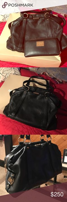 BLACK LEATHER MICHAEL KORS PURSE & matching wallet BLACK LEATHER MICHAEL KORS PURSE & matching wallet - worn for about a month. NON SMOKING, no animals. No scuffs or burns. Great condition. MAKE OFFER IF YOU DONT LIKE PRICES. Michael Kors Bags