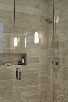 i like the neutral tiles the glass surround and wood tile