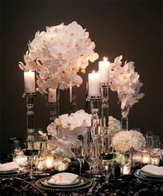 Super Luxe...  Phalaenopsis orchids,crystal candle sticks,candlelight. Love this!!!