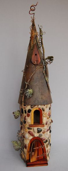 Amazing birdhouses!!!  I wonder whether we could make something like this for the fairy garden this summer.