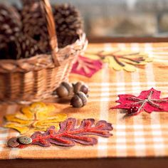 Accent your Thanksgiving table with a Felt Leaf Table runner you can make. Plus get 25 more fall entertaining and decorating ideas.