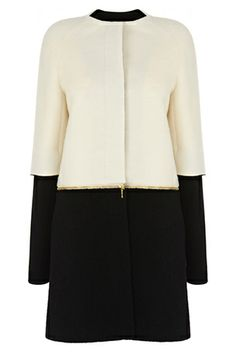 The Izzy Mono Zip Coat is crafted from a soft alpaca wool blend. This minimalistic two-tone coat features raglan sleeves, a collarless neckline, sleeves with full length jersey undersleeve and can be zipped off at the waist giving it a modern twist.