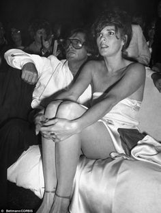 """With former husband Robert Evans by her side, actress ALI MacGRAW sees something of interest during a party to celebrate the June 6 premiere of her new movie """"Players.""""   In the film Ali plays an older woman who has an affair with a young tennis player. Evans produced the Paramount Pictures release Paul Bakers and actress Margaux Hemingway."""