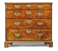 In Awe/  Yew is my favourite  wood  Sotheby's A George II yew-wood chest of drawers, with a quarter veneered top above four graduated long drawers on bracket feet