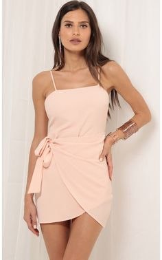 Style: Playful wrap dress features double tie closure for adjustable style and fit. Adjustable straps included, zipper closure for easy on-and-off. Lining included for additional coverage. Comes in a lovely shade of blush. - Made In Los Angeles Rush Dresses, Homecoming Dresses Tight, Hoco Dresses, Pretty Dresses, Evening Dresses, Sexy Dresses, Tie Dress, Dress Skirt, Wrap Dress Short