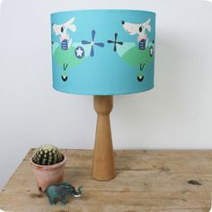 Dylan Dog lampshade (blue) by Rebecca Sodergren.   A beautiful, scandi inspired lampshade.  Diameter 30cm, it can be made with either a lamp or pendant fitting.   Ideal for a child's nursery, bedroom or even a lovely feature for a stylish room.   Matching cushion available.    #Kids interiors  #childsbedroom #nurseryideas  #lampshades #scandidesigns #matchinglampshadeandcushion