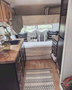 Chic black cabinets in this gorgeous camper by 😍 . Shasta Camper, Tiny Camper, Camper Trailers, Caravan Makeover, Caravan Renovation, Ducato Camper, Popup Camper Remodel, Van Home, Rv Interior