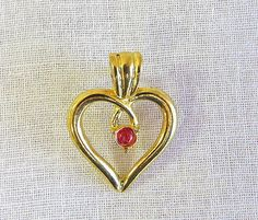 Vintage gold tone heart pin with red crystal by Antiqueandsupplies