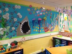 Under the water theme display - Phoneme Set on Rainbow Fish - twinkl i like the vines coming down from the ceiling like under the sea plants and i like the treasure box Class Displays, School Displays, Classroom Displays, Classroom Themes, Library Themes, Sea Activities, Seaside Theme, Ocean Unit, Under The Sea Theme