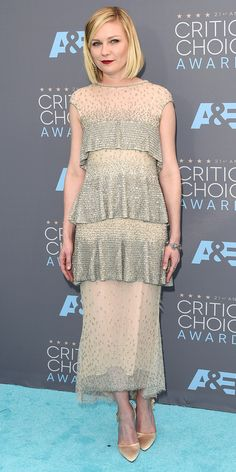 Critic's Choice Awards 2016: KIRSTEN DUNST channels her inner flapper in a tiered Chanel Haute Couture shift with sparkling overlays, plus a deep wine lip, vintage Fred Leighton diamonds and satin heels.