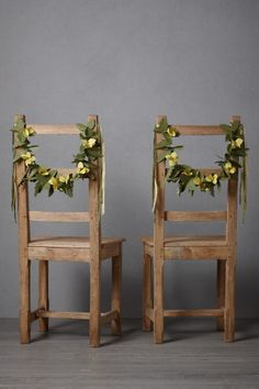 "Pair of ""Forever Flowers"" Chair Garlands made of Chartreuse blossoms & hand-cut leaves to decorate the land & gentleman of honor."