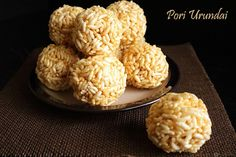 Pori Urundai is a traditional South Indian sweet made with puffed rice, jaggery and flavored with cardamom, ginger powders. It is perfectly sweet n crispy.
