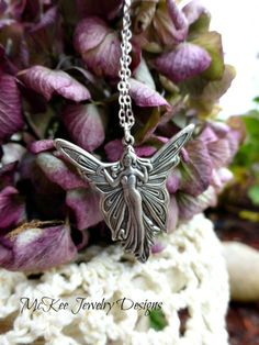 Enchanting fairy necklace features a detailed fairy charm as a pendant on a dainty silver chain. With lobster claw clasp for secure wear. Very lightweight with gentle swing. Silver charm is plated wit