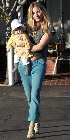 cuff a baggy pair of jeans, add heels and off we go -  baby in tow